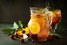 Homemade Refreshing Wine Sangria Or Punch With Fruits. Sangria Cocktails With Fresh Fruits, Berries And Rosemary On Dark A Stone Or Slate Background. Copy Space.