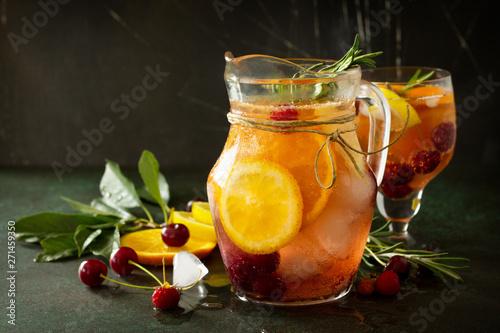 Valokuvatapetti Homemade refreshing wine sangria or punch with fruits