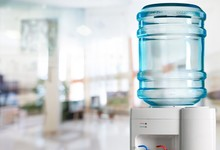 Plastic Water Cooler Over Nature Background