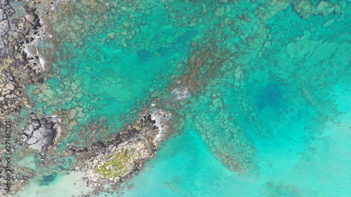 Canvas Prints Turquoise Aerial top view photo of men practising wind surfing in exotic paradise open ocean bay with crystal clear turquoise sea