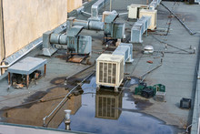 Air Conditioning Systems On Roof Of Commercial Buildings. The Rooftop Location Benefits From Less Noise Pollution, Minimize Dirt And Damage, Increased Security, Space Savings And Ease Of Maintenance