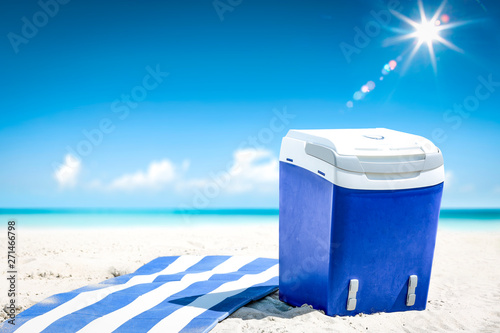 Poster Ecole de Danse Summer time on beach and blue beach fridge on sand. Ocean landscape and sunny day.