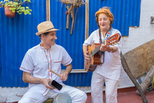 Happy Street Musicians Playing Guitar And Cowbell Singing In The Street In Old Havana