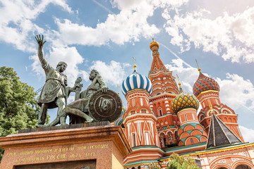 Fototapeta na wymiar Famous landmark St Basil Cathedral with Minin and Pogarsky statue