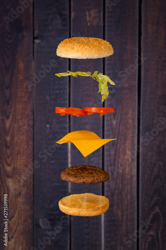 Burger floating with wood background