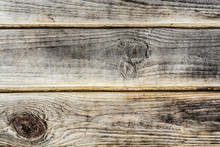 Texture Of An Ancient Wooden Wall, Old Dried Wood With A Lot Of Cracks And Peeling Fibers, Closeup Abstract Background