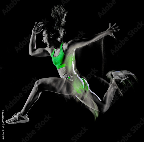 fototapeta na drzwi i meble one mixed race woman exercising fitness exercises isolated on black background with lightpainting effect