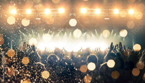 Concert spectators in front of a bright stage with live music - 271516500