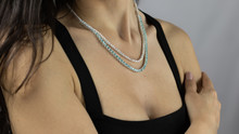 Precious Necklace With Bright Gemstones On The Neck Of A Young Woman