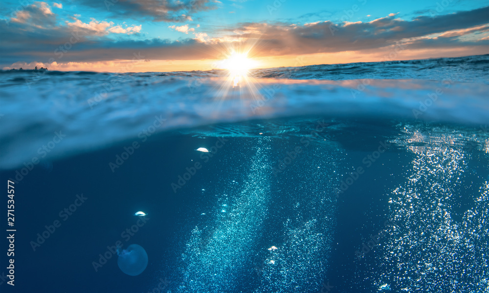 Fototapety, obrazy: Water background, beautiful tropical sea, underwater view with sunset on skyline