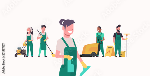Fotografia janitors team cleaning service concept male female cleaners in uniform working t
