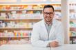 Leinwandbild Motiv Smiling portrait of a handsome pharmacist.