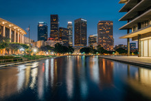 The Downtown Los Angeles Skyline At Night, With The Reflecting Pool At The Department Of Water And Power, In Los Angeles, California