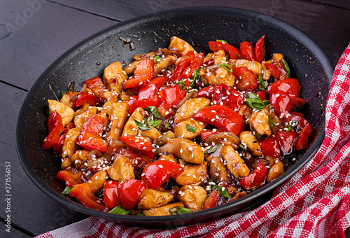 Stir fry chicken, sweet peppers and green onion. Asian cuisine