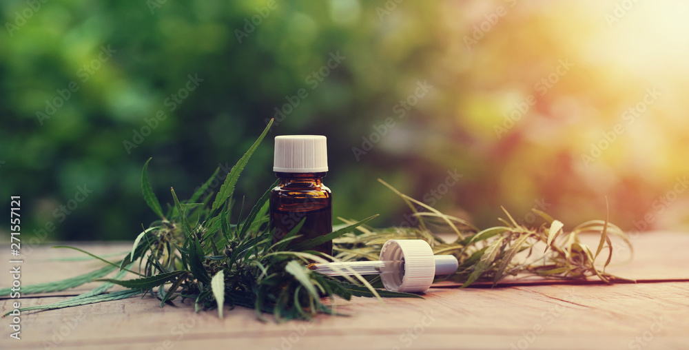 Fototapety, obrazy: Cannabis herb and leaves with oil extracts in jars. medical concept