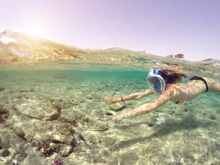 Woman snorkeling close to c...