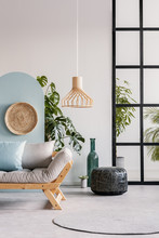 Wicker Accents In Bright Living Room Interior With Flowers