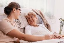 Elderly Woman In Hospital Bed ...
