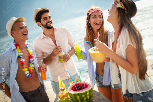 Group of friends enjoy on the beach on summer vacation