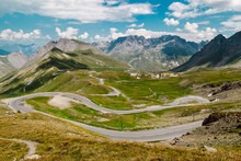 View Above A Beautiful Landscape Of Valley In Alpine Mountains  With Serpentine Roads. Alpine Road In High Mountains - Steep Road Between The Village Valloire And The Col Du Galibier Pass, French Alps