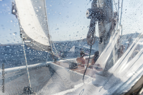 Foto  Sailing yacht catamaran sailing in rough sea