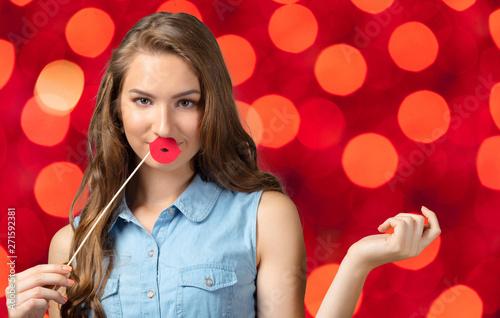 Fototapeta Cheerful happy young beautiful girl looking at camera smiling