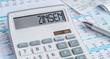 Leinwandbild Motiv Taschenrechner mit Dokumenten - Zinsen