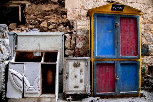 Locked cupboard and timeworn safe in front of an weathered Wall in Cairo Wallpaper Mural