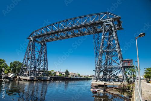 Old Nicolas Avellaneda steel bridge across Matanza River in La Boca, Bueno Aires Fototapeta