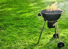 Burning Fire With Flames In A Portable BBQ