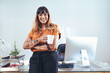 Leinwanddruck Bild - Creative woman entrepreneur standing in office