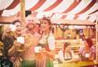 canvas print picture - Freunde auf dem Oktoberfest im Bierzelt mit Maß Bier