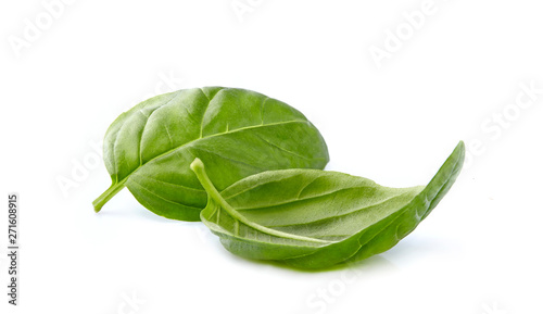 Foto Basil leaves in closeup on white background