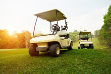 Golf Cart On Fairway In Golf Course.