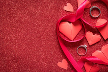 Diamond Rings On Red Glitter Texture, Valentines Day And Romance Concept, Wedding Anniversary Gift