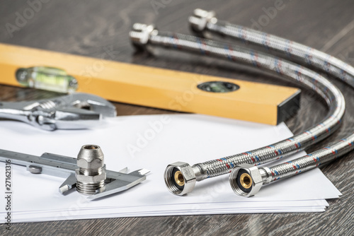 Fotografia  Steel water fittings for hydraulic system