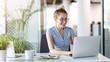 Leinwandbild Motiv Young business woman working on laptop in office