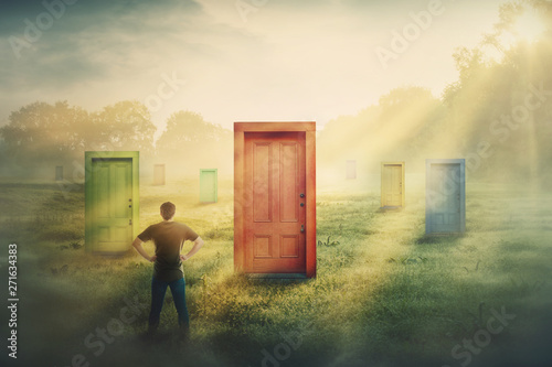 Photo  Doubtful man in front of many different doors choosing one