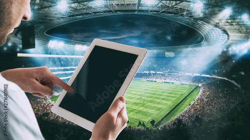 Canvas Print Man with tablet at the stadium to bet on the game