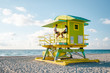 canvas print picture - Miami south Beach, youn couple men and woman on the beach during sunrise. Miami beach Floarida