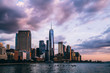 Panoramic view of Manhattan Island with buildings and Hudson river. Scenery skyline view of contemporary glass skyscrapers of downtown financial district in New York. Dramatic sunset sky over city