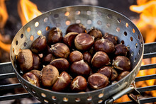 Metal Roaster Filled With Fresh Autumn Chestnuts