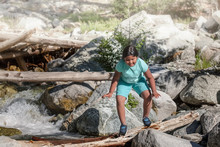 A Little Girl Crossing A Wodden Log Over River Rapids During Summer Camp, Weight Loss Activity For Children.