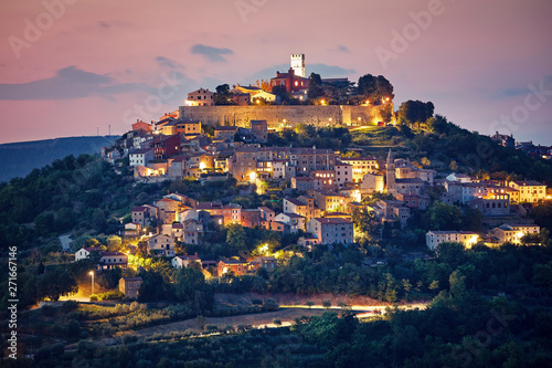 Obraz Croatia. Vintage Motovun walled city fortress on the hill. Picturesque evening sunset landscape. Summer panorama. Backlighting illumination at houses and walls. - fototapety do salonu
