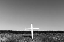 A Cross On A Hillside, A Grave...