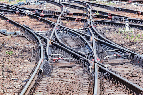 Photo Railway tracks on the big station at day time.