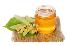 Jar Of Linden Honey And Lime Flowers On Linen Napkin Isolated On White Background.