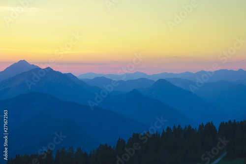 Tuinposter Zwavel geel DRONE: Flying over the golden lit mountains of Slovenia on a sunny evening.