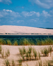View Of The Great Dune Of Pilat From The Cap Ferret With A Grassy Dune In The Foreground