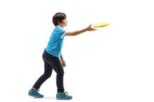 Boy Throwing Frisbee